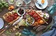 canvas print picture - Mediterranean appetizers platter. Diner table with antipasto selection: cured meat and salami, gazpacho soup, jamon, olives, cheese, hummus and vegetables.   Overhead view.