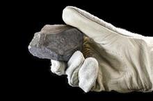 Miner Hand Holding Iron Stone,...