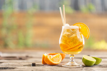Beer Lemonade With Orange And Ice On A Garden Table During A Hot Summer Day