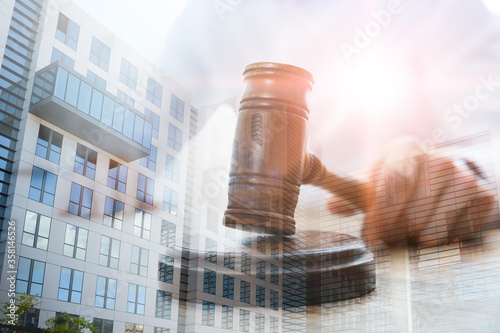 Stampa su Tela Law protection. Double exposure of judge with gavel and building