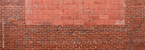 Panorama of red brick and painted concrete block wall, creative copy space opportunities, horizontal aspect