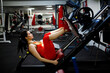 Girl in the gym. Goes in for sports, on exercise machines