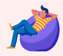 Young Man Sitting And Chilling On Bean Bag. Man Is Resting In Bag Chair. Freelancer Relaxing After Work. Hipster Character In Jeans And T-shirt. Flat Vector Illustration