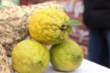 Yellow Green Lemons On White Table