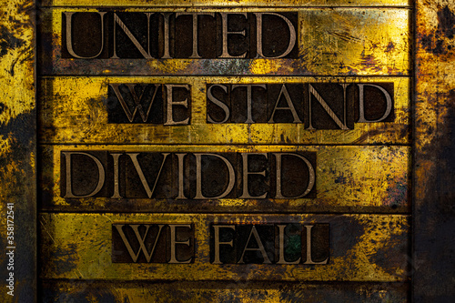 Fotomural United We Stand Divided We Fall text formed with real authentic typeset letters