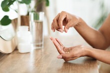 Unrecognizable African Woman Taking Beauty Supplements For Glowing Skin