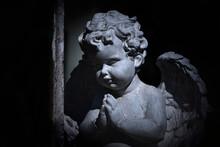 Little Angel Praying. Black An...
