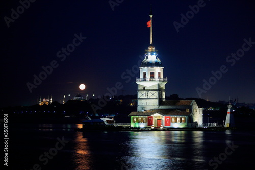 Maiden's Tower, Istanbul. Night view of historic Maiden's Tower with moonlight. Turkey © Suat
