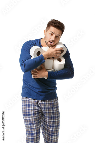 Canvas-taulu Young man with many rolls of toilet paper on white background