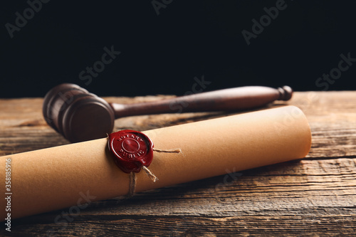 Scroll with notary public wax seal and gavel on table Slika na platnu
