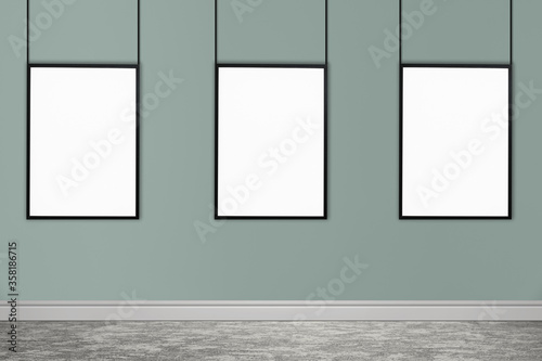 Fototapeta Frames with empty canvases on grey wall in modern art gallery. Space for design obraz