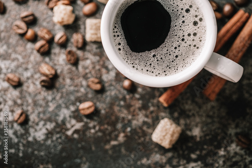 Obraz na plátně Coffee cup and coffee beans on dark stone background.