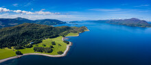 Aerial Image Of Loch Linnhe On The West Coast Of The Argyll And Lochaber Region Of Scotland Near Kentallen And Duror Showing Calm Blue Waters And Clear Skies With Green Forest Coast Line