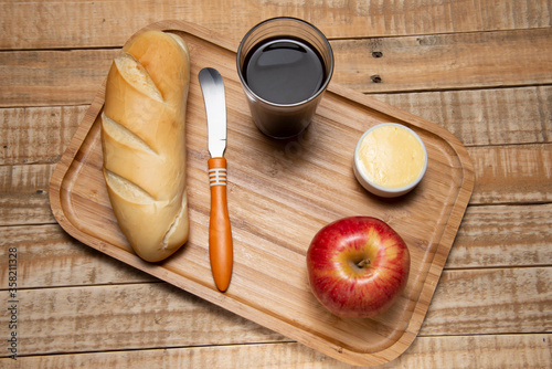 simple breakfast, with bread and butter, coffee and fruit Canvas Print