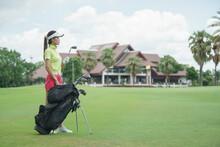 Female Player Choosing Golf Cl...
