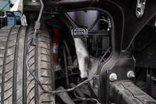 View Of A Disassembled , Suspension Swamp Buggy. Close-up Of A Car Hub, Brake Caliper, Brake Pads, Brake Disc, Wheel Bearing Prepared For Repair.
