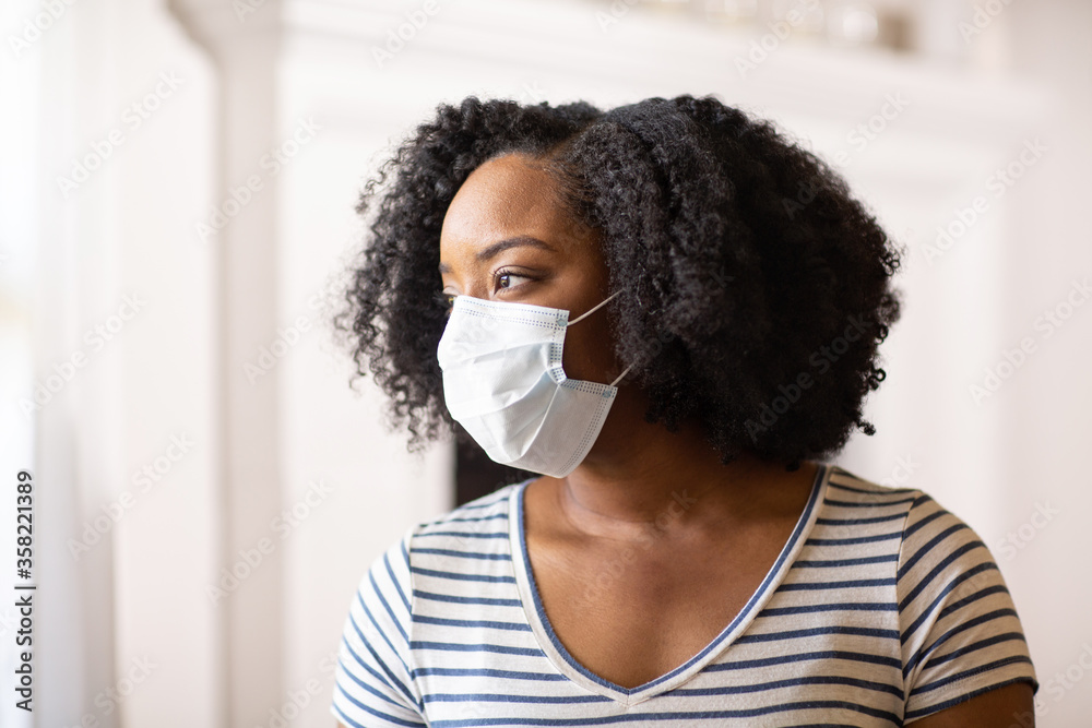Fototapeta Close up view of an African American woman wearing a face mask