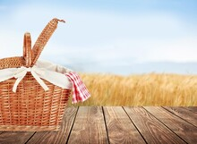 Picnic Basket With A Tableclot...