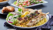 Greek Chicken Souvlaki Platter With Pita Bread, Salad And Rice