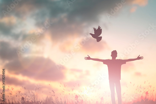 Fototapeta Happy man rise hand Worship God in morning view
