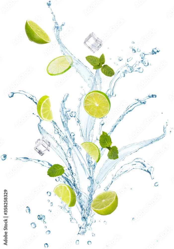 Fototapeta water splash with mint leaves, slices of lime and ice cubes isolated on white background