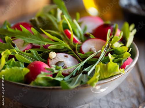 Fresh vegetable salad with radish, arugula and lettuce Canvas Print