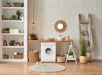 Laundry room interior style, washing machine wicker basket white bookshelf and sink.