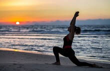 Woman Doing Yoga At The Beach ...