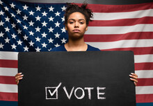 Black Woman Holding Vote Sign ...