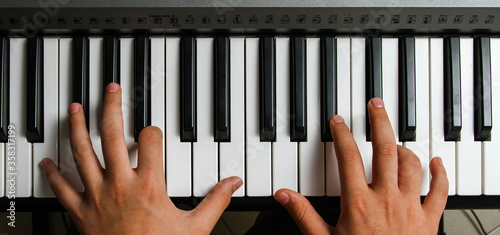 hands playing piano Canvas Print