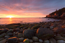 Sunrise On A Rocky Beach In Ac...