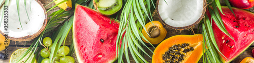 Fototapeta Assorted different summer tropical fresh raw fruits and berries. Clean eating, healthy lifestyle, diet and vitamin concept.  obraz