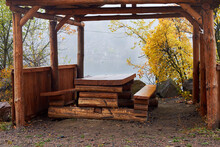 A Gazebo With A Wooden Table Near The Lake In The Early Foggy Autumn Morning