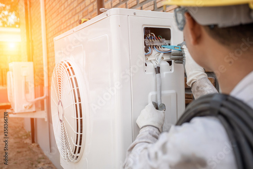 Air Conditioning Technician and A part of preparing to install new air conditioner Canvas