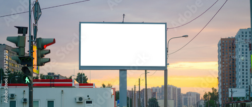 Fototapeta Advertising billboard advertising large horizontal screen MOCKUP for advertising. Against the background of the sunset, glowing. obraz