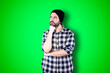 canvas print picture - Caucasian handsome man isolated on chroma background thinking an idea while looking up