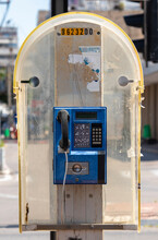 Blue Public Payphone On A City...
