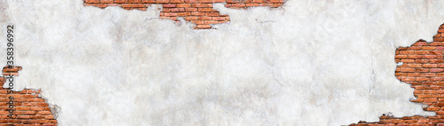 Fotografie, Obraz Vintage brick wall background, surface with crumbling plaster