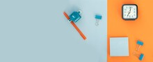 Set Of School And Office Supplies On Bright Blue (turquoise) And Orange Background: Pen, Clips, Note Paper, Toy Robot. Concept: Back To School. Flatlay, Top View.