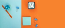 Set Of School And Office Supplies On Bright Blue (turquoise) And Orange Background: Pen, Clips, Note Paper, Toy Robot, Alarm. Concept: Back To School. Flatlay, Top View.