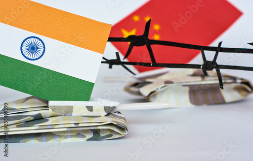 Chinese and Indian flags on tanks between barbed wire, grunge style photo Wallpaper Mural