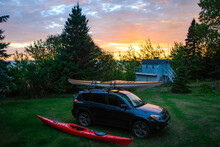 Loading Kayaks On Roof Racks At Dawn For A Day Of Paddling.