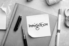 Note With Word IMMIGRATION And Stationery On Grey Table, Flat Lay