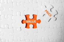 Puzzle With Phrase PRICE VALUE On Orange Background, Top View