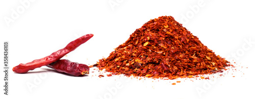 Red hot chilies with powder over white background. Fototapet