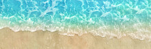 Close-Up Of Blue Summer Water Wave Tide And Sea Foam Washing Up On Ocean Beach Shore Sand Texture Background, Panoramic From Directly Above