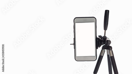 Fotografía Mobile phone mounted on a tripod with a white background for self-portraits