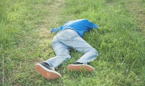 Obraz Caucasian unconscious man in outdoors. - fototapety do salonu