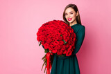 Photo of adorable charming chic lady hold large red long roses bouquet secret admirer boyfriend birthday surprise wear green mini dress isolated pastel pink color background