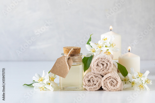 Jasmine essential oil, candles and towels, flowers on a white background Wallpaper Mural